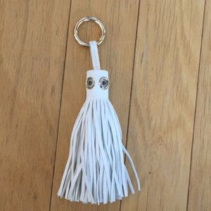 Leather tassel keychain with googley eye detail